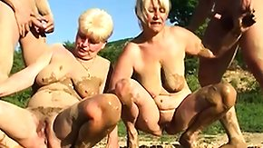 HD Saggy Sex Tube Saggy tittied ight golden-haired grannies gets maimed in the mud pit outdoors
