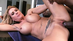 Free Fake Tits HD porn Blonde bimbo with fake milk sacks swallows a big ebon cock's load
